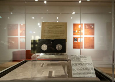 Exhibit case featuring 'The Edinburgh stereoscopic atlas of obstetrics' by G.F. Barbour Simpson, ed.